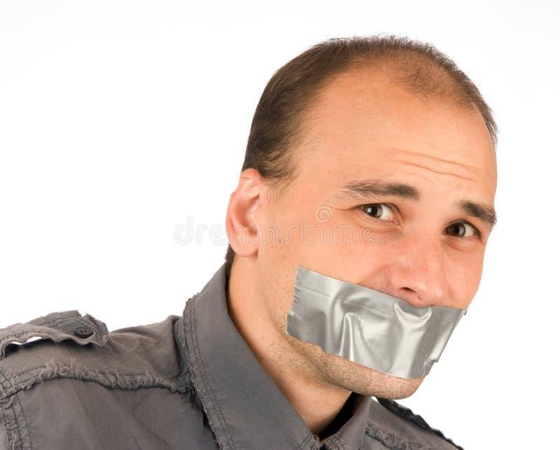 Man silenced stock photos