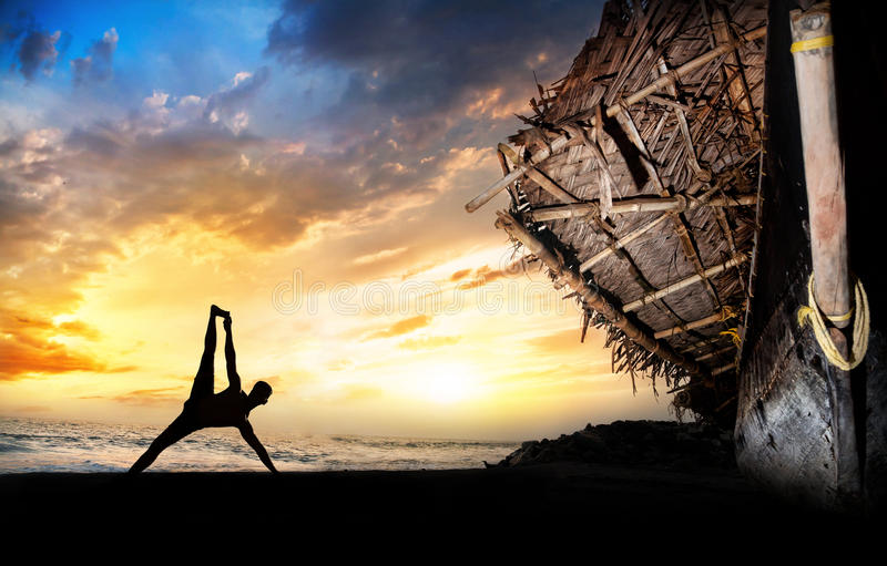 Man silhouette doing yoga