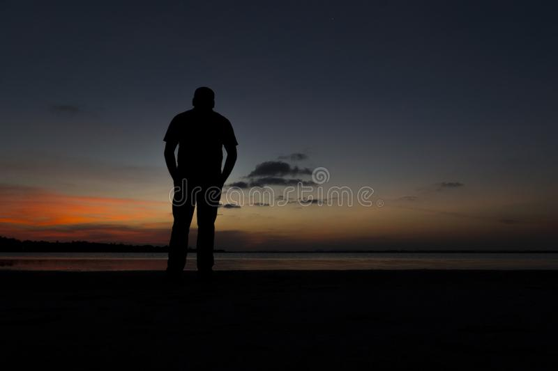 A man in the silhouette stock image