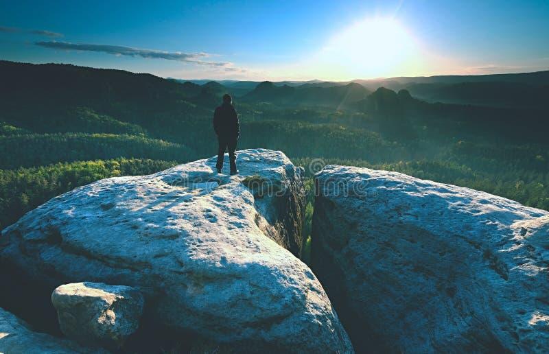 Man silhouette stay on sharp peak. Satisfy hiker enjoy view stock image