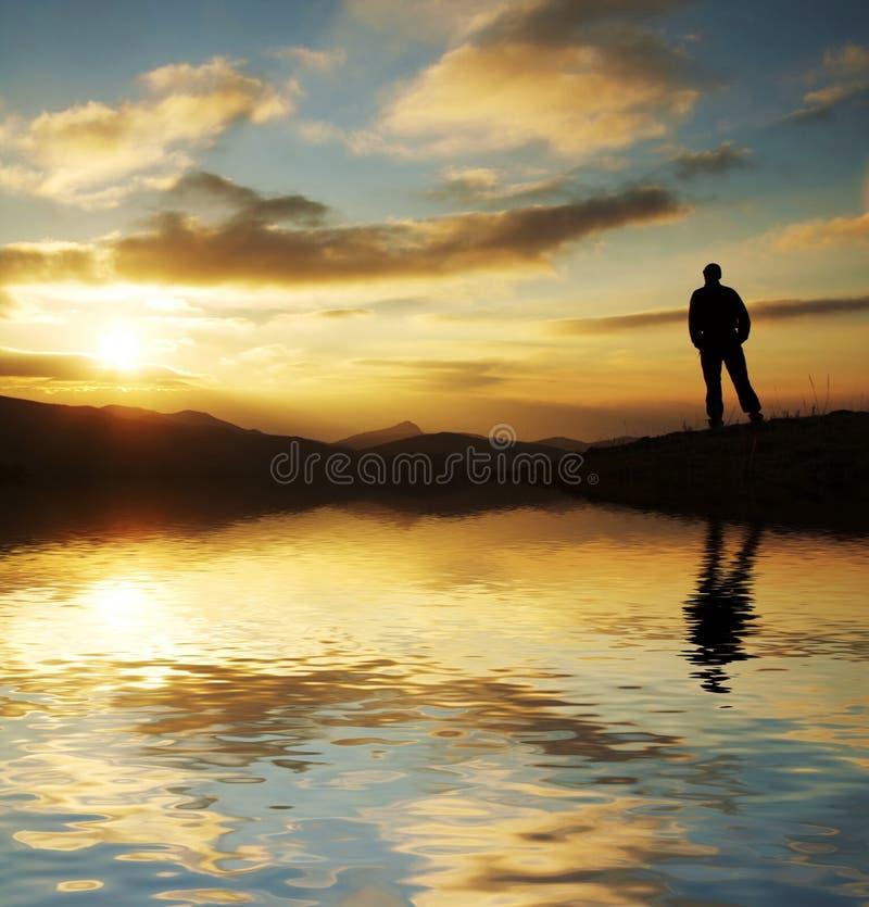 Man silhouette on sunset stock image
