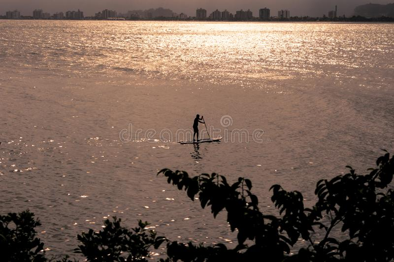 Man surfing from stand up paddle royalty free stock photo