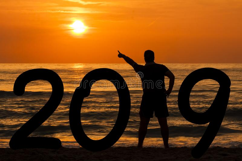 Download Man Silhouette Year 2019 At Sunrise At Sea Stock Photo - Image of seascape, beginning: 107073080