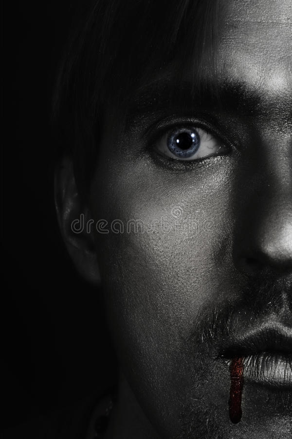 Man with silver paint on his face royalty free stock image