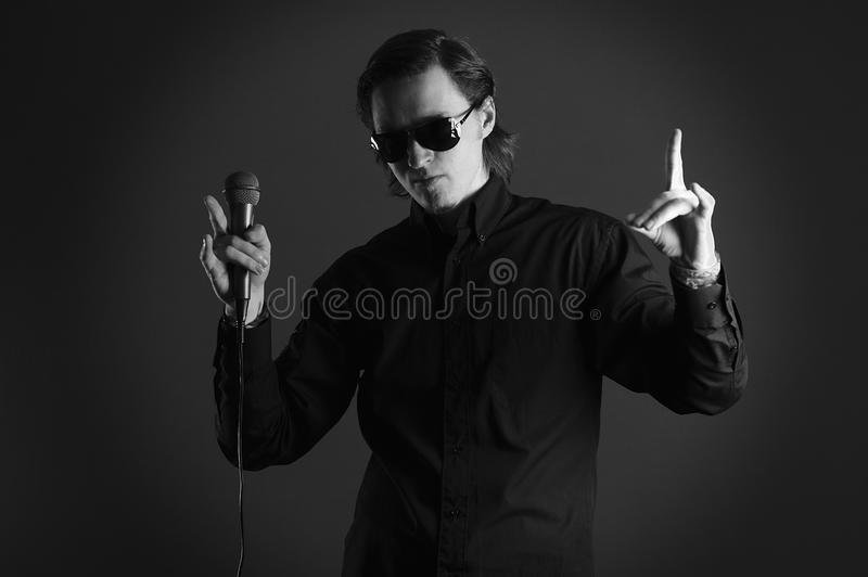 Download Man Singer With Microphone Hands Up, Fingers Point Stock Image - Image: 23635741