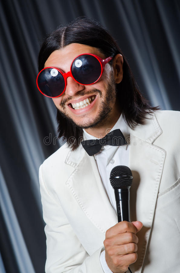 Man singing in front of curtain royalty free stock photos