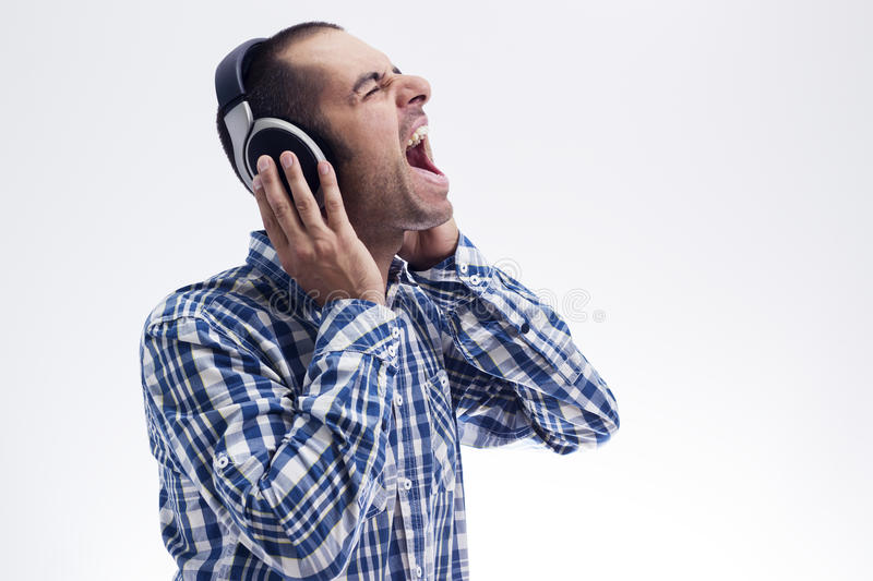 Man singing with headphones royalty free stock photography