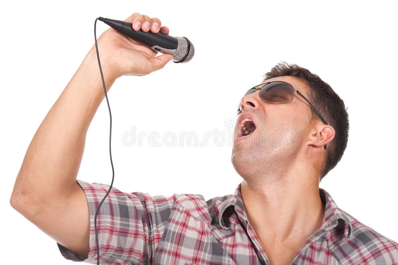 Man singing with a microphone on the hand stock photos