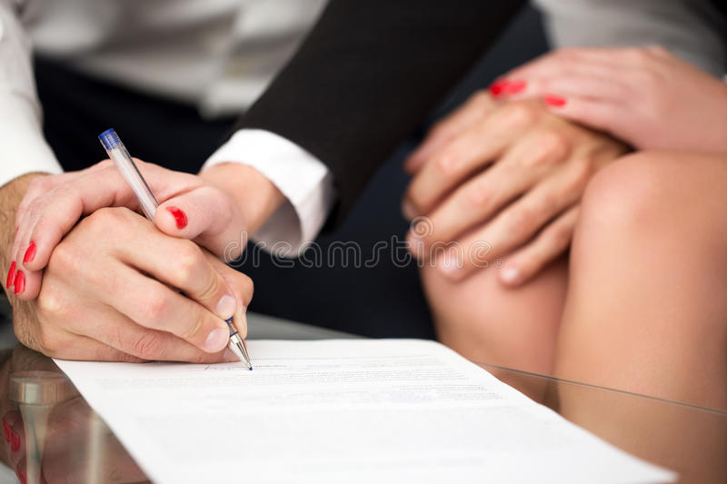 Man singning marriage settlement stock images