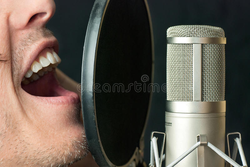 Download Man Sings Into Condenser Microphone, Close Royalty Free Stock Photography - Image: 26381607