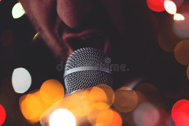 Man sings karaoke in a bar royalty free stock photo