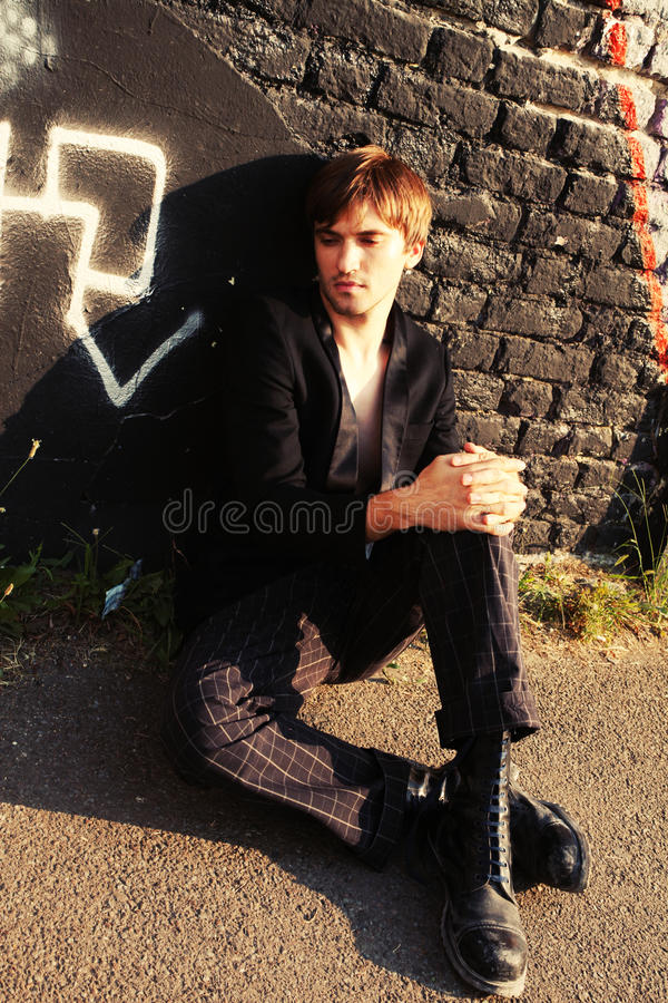 Download Man sit by the wall stock image. Image of model, graffiti - 20937389