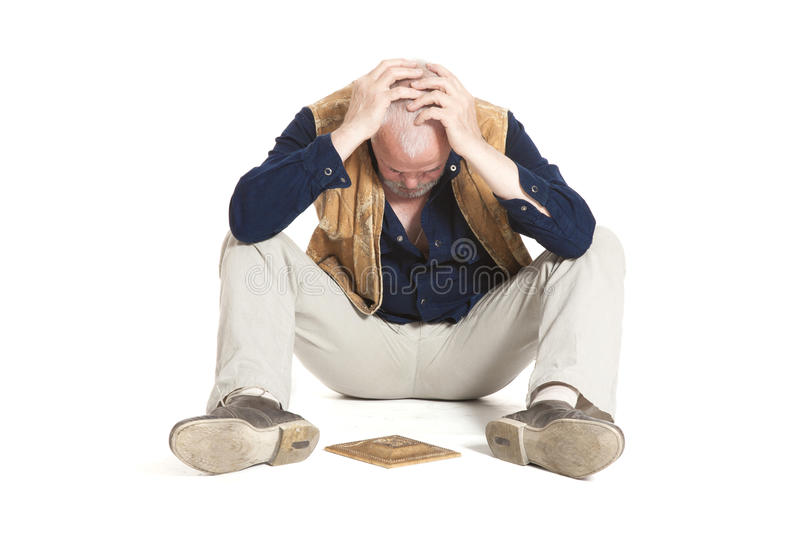 Man sits on the floor with gilded fretwork. On white background royalty free stock photos