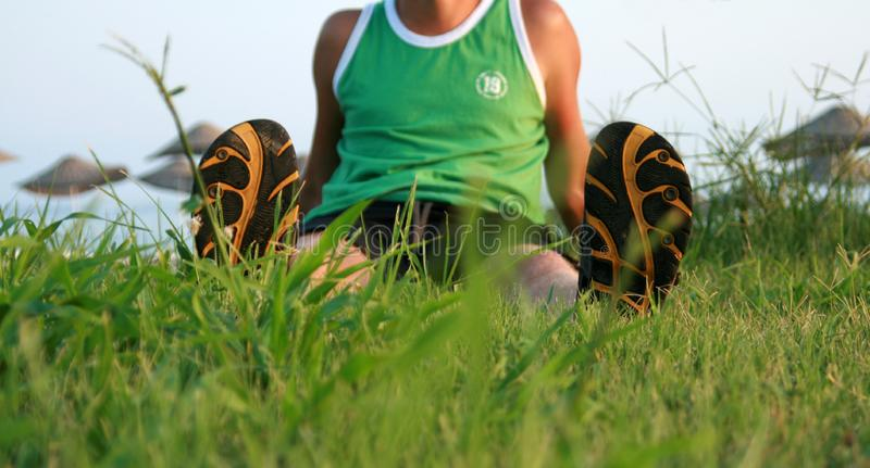 Man sits on grass royalty free stock photos