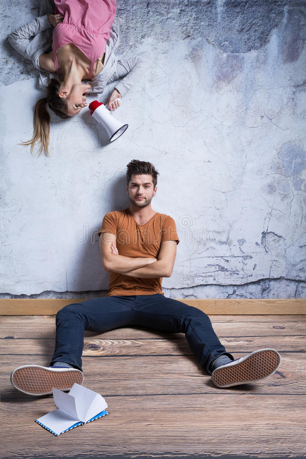 Man sitting against wall royalty free stock photography