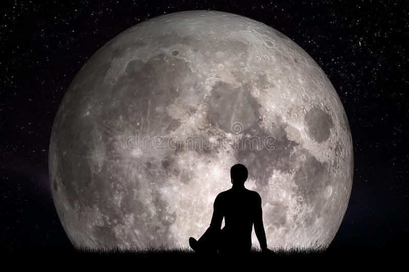 Man sitting alone on grass and looking on moon. Imagine the future concept. 3D rendering. Elements of this image furnished by NASA royalty free stock image