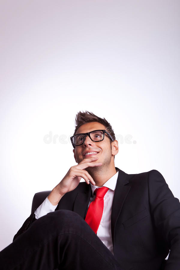 Download Man Sitting In An Armchair And Dreaming Stock Image - Image: 26587307