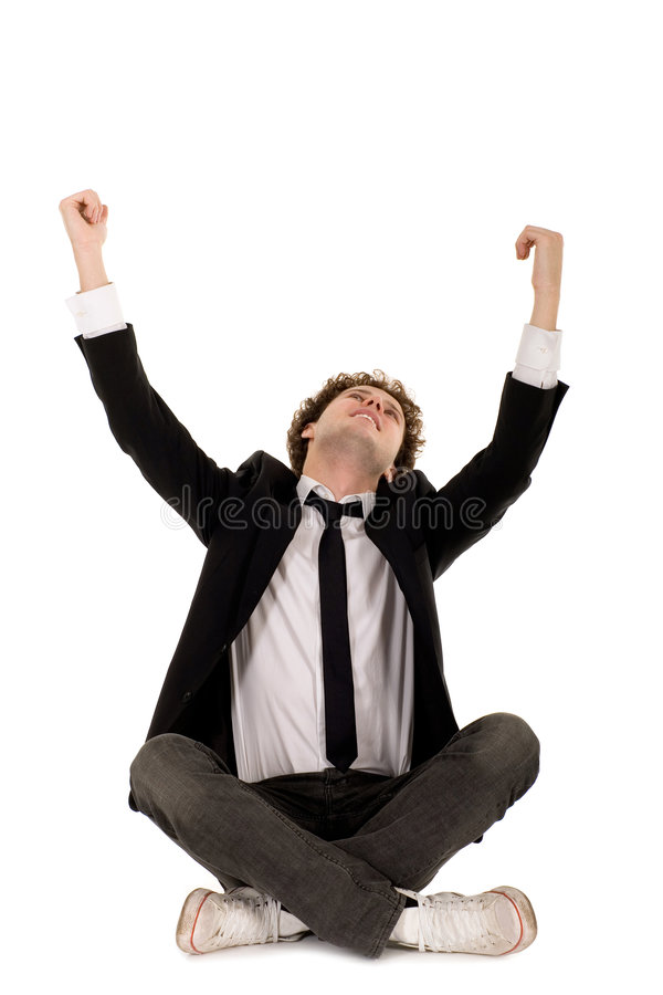 Man Sitting With Arms Raised Royalty Free Stock Photos