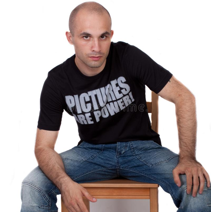 Man sitting on a chair royalty free stock photos