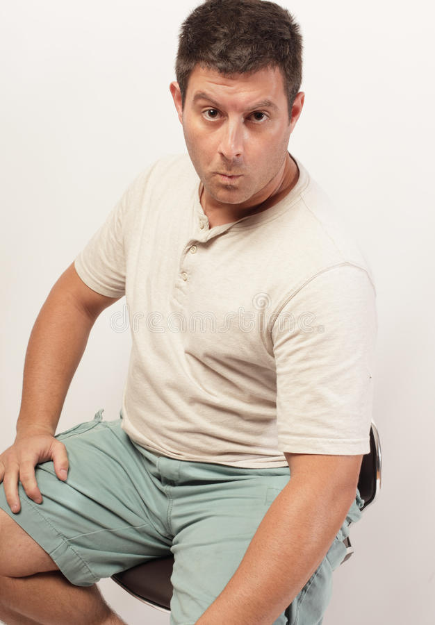 Man sitting on a chair stock photo