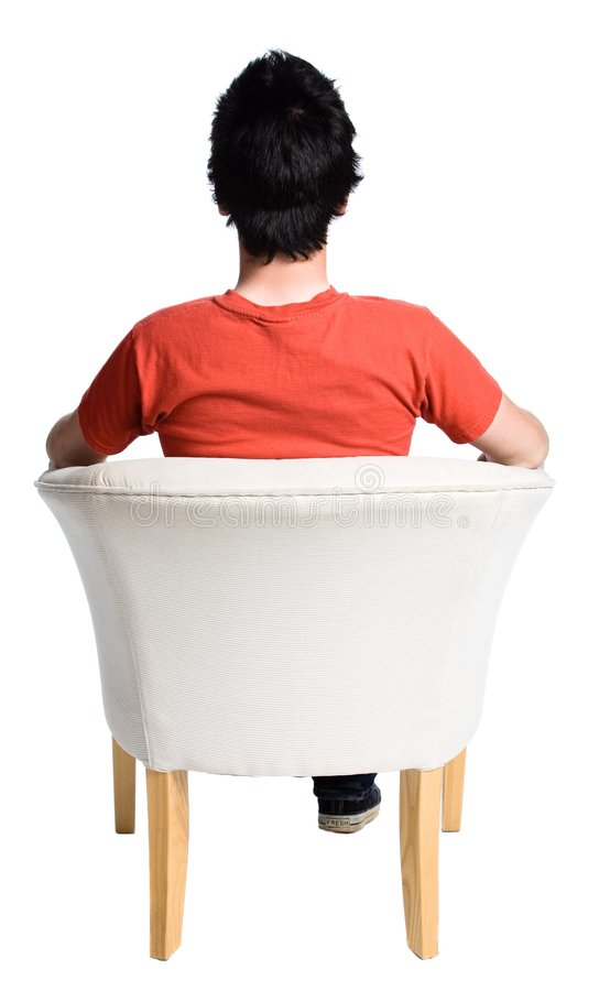 Man sitting on a chair royalty free stock image