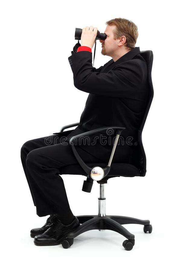 Download Man Sitting In Chair And Searching With Binoculars Stock Image - Image: 21272753