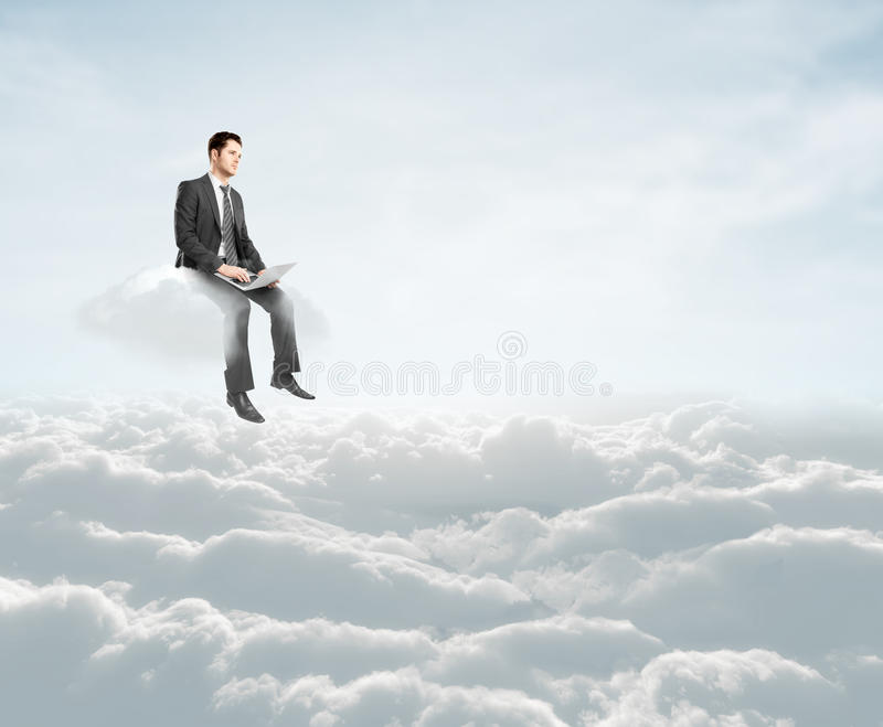 Man sitting on cloud. Young man with laptop sitting on cloud stock images