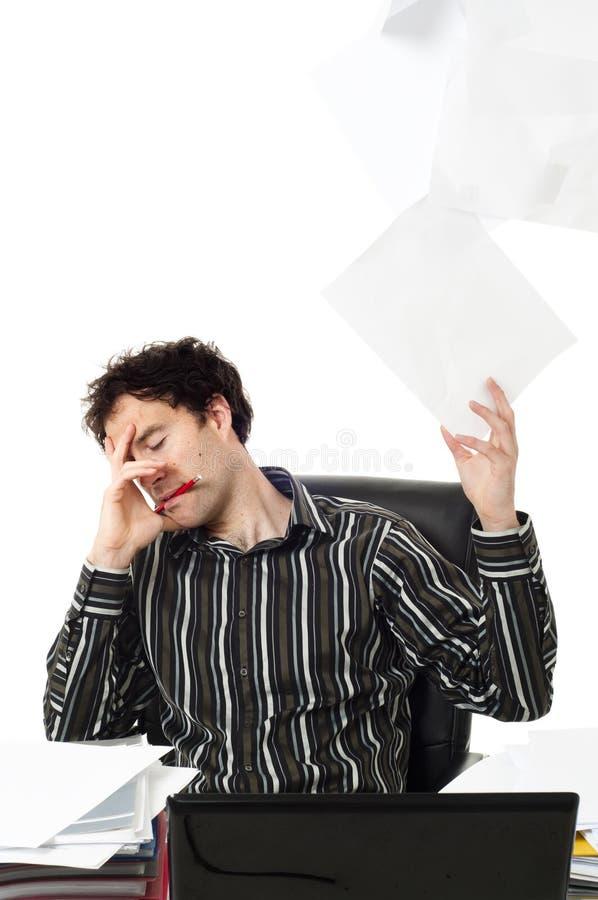Man sitting at desk stock photo