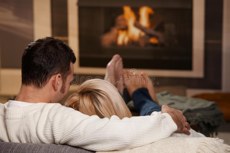 Man sitting at fireplace stock photography