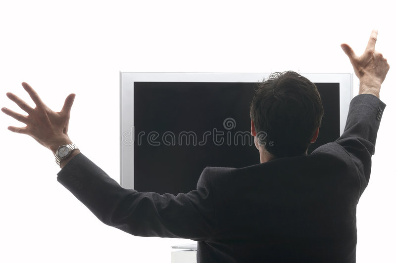 Man sitting in front of a LCD - TV cheering stock photos