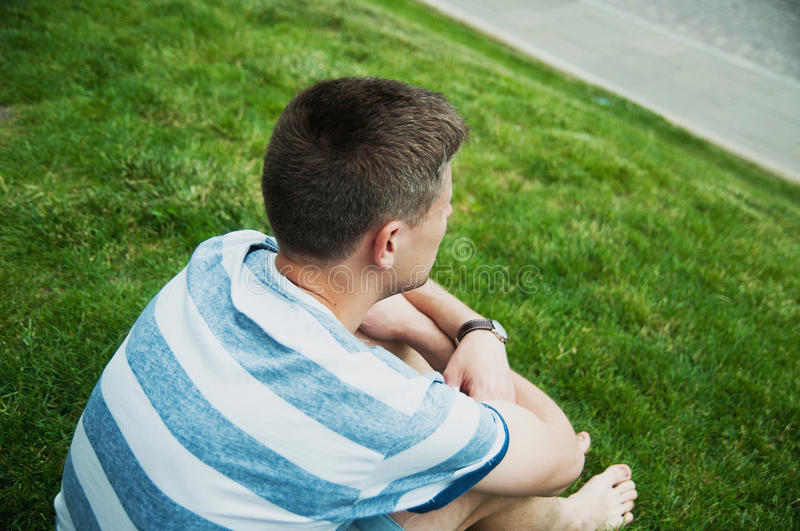 Man sitting at grass royalty free stock images