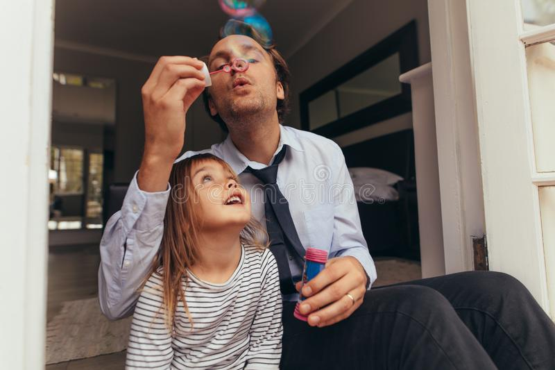Father and daughter playing at home stock photo