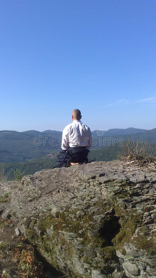 Zen meditation on the top of the mountain royalty free stock photos