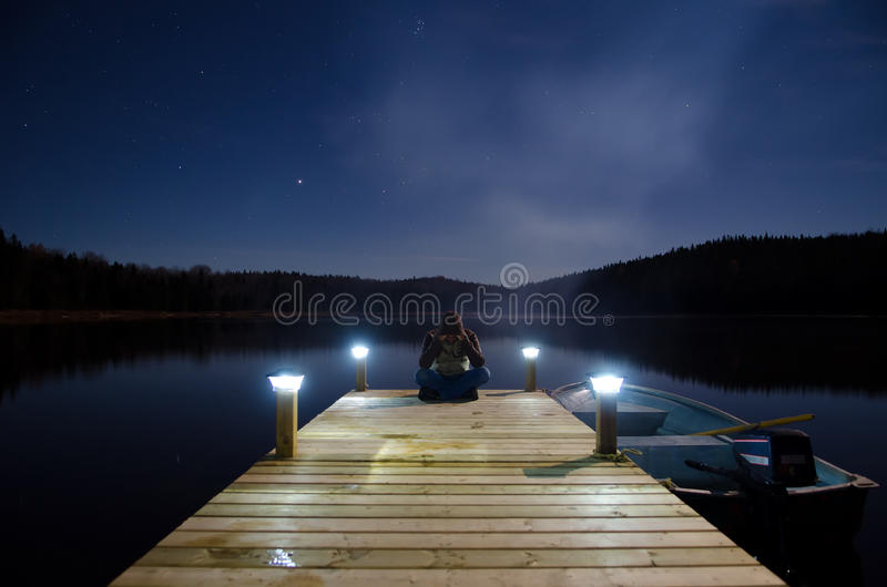 Man sitting on jetty royalty free stock image