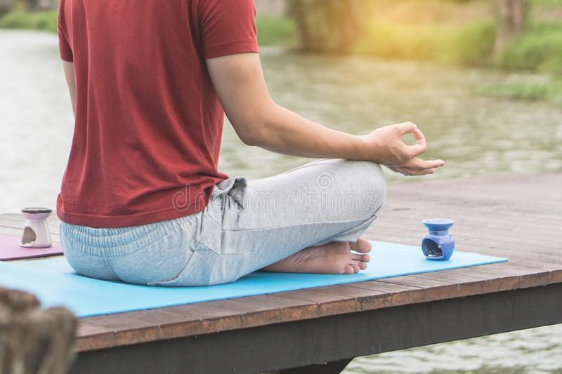 Man beside the lake and doing meditation in morning at lake royalty free stock photos