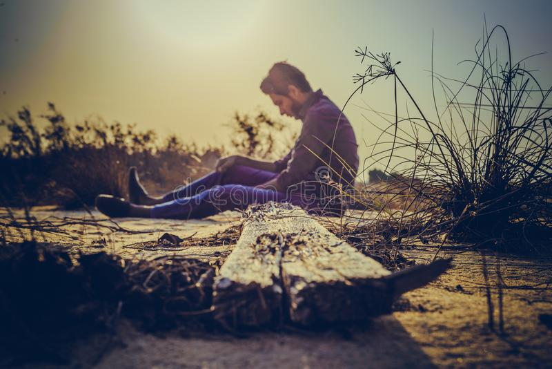 Man Sitting Near Brown Wood Plank stock photos