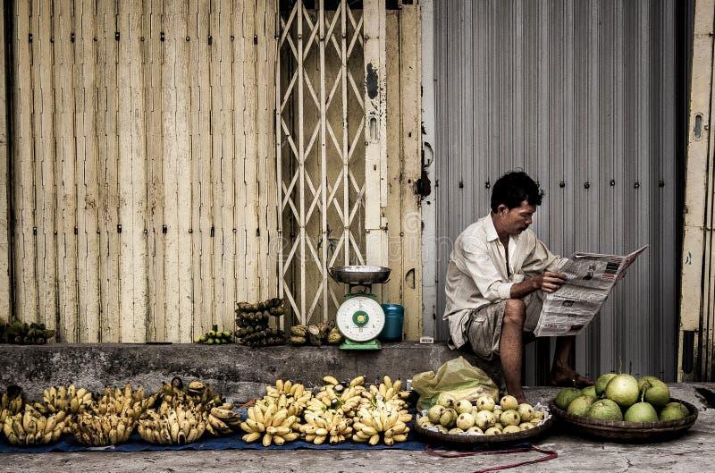 Man Sitting Near Fruits royalty free stock images