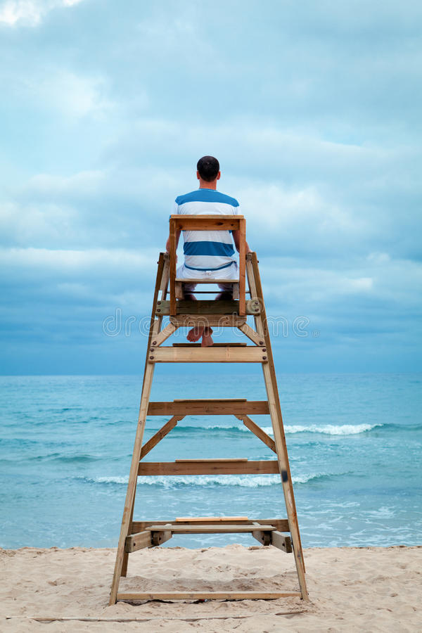 Free Man Sitting On Lifeguard Chair Stock Photography - 32971212