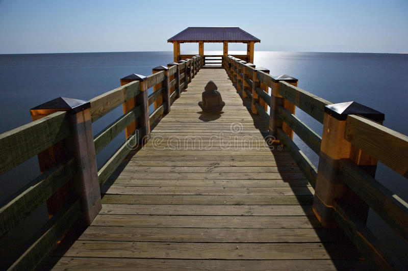 Man Sitting on Pier royalty free stock photography