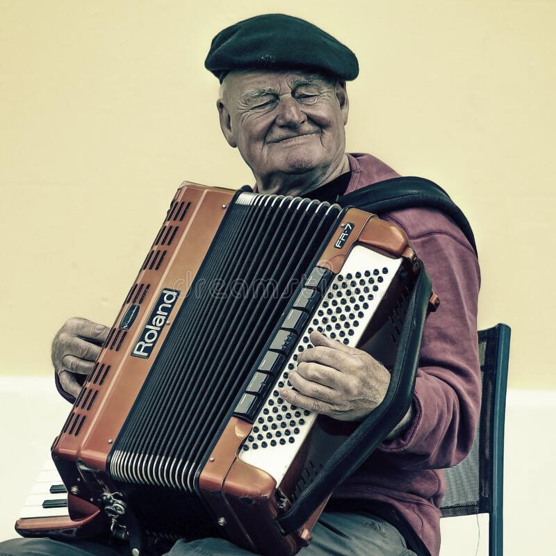Man Sitting Playing Accordion Free Public Domain Cc0 Image