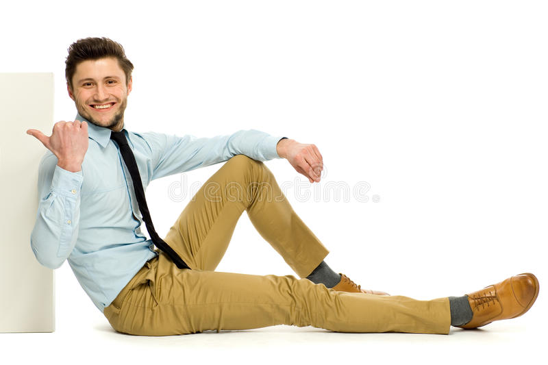 Download Man Sitting And Pointing At Blank Poster Stock Image - Image: 24300801