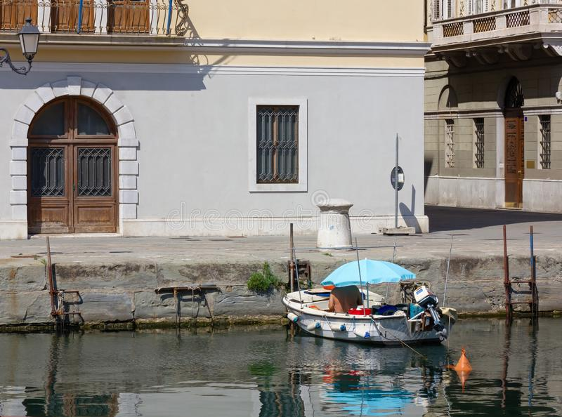 Man Sitting in a Small Boat in Trieste royalty free stock image