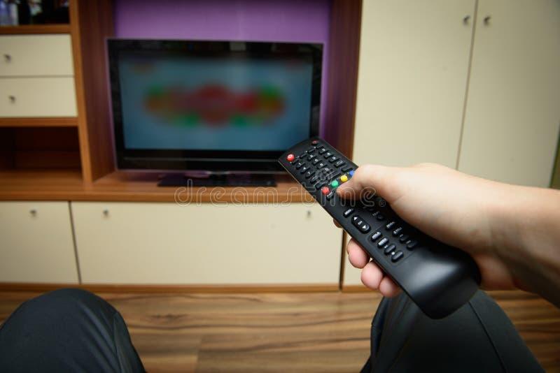 Man Sitting On A Sofa Watching Tv Stock Photo