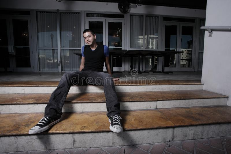 Man sitting on the steps stock image