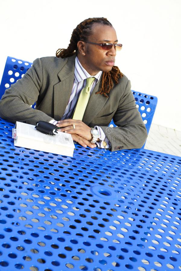 Man Sitting at a Table stock photography