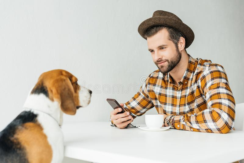 man sitting at table and looking stock images
