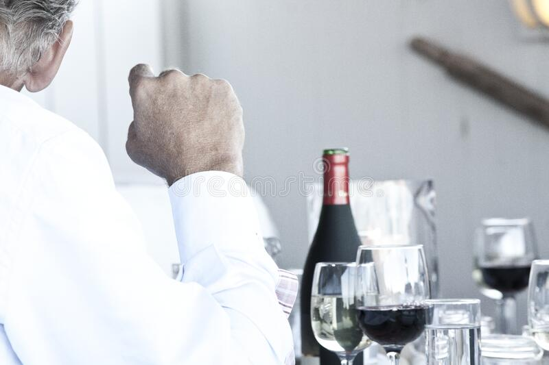Man sitting at table stock images