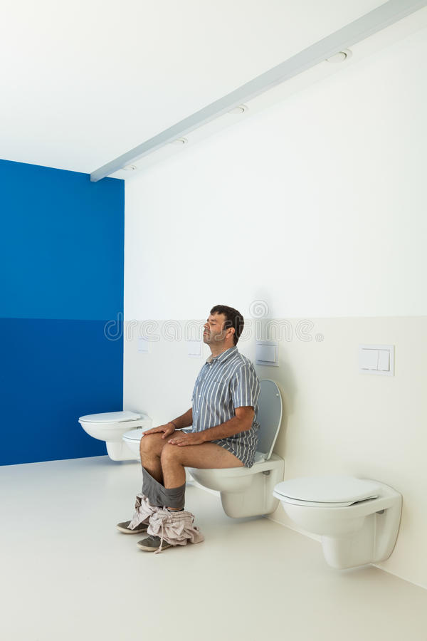 Man Sitting On The Toilet Royalty Free Stock Photo - Image ...