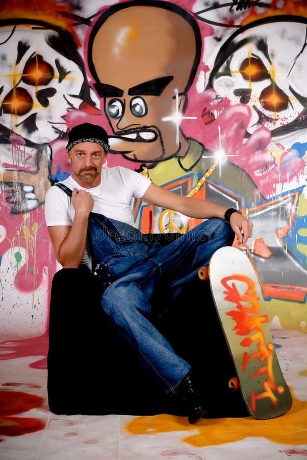 Man skateboard, graffiti wall royalty free stock images