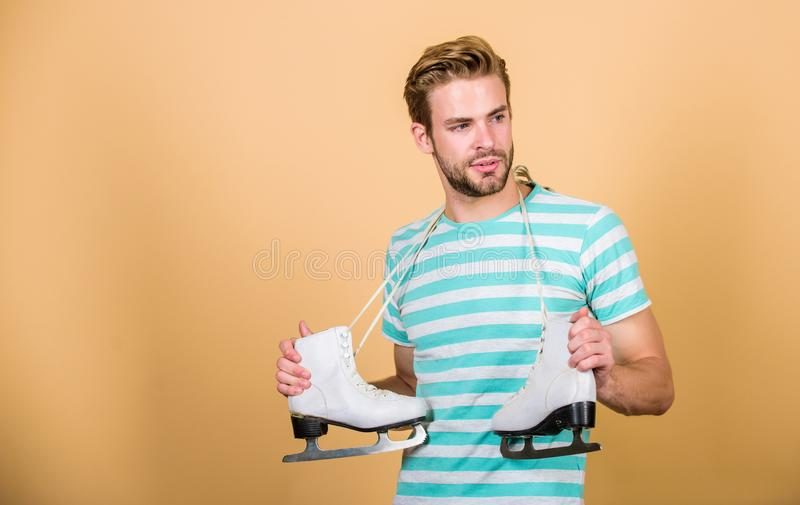 Man with skates. sport equipment. winter activity. i love figure skating. copy space. Winter fun on Christmas holidays royalty free stock image